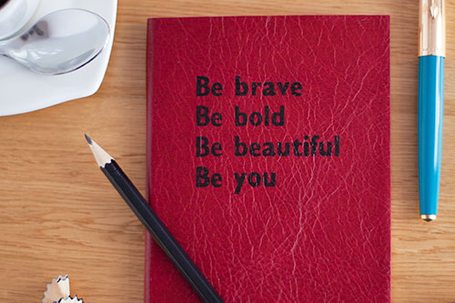 Notebook with words be brave, be bold, be beautiful, be you