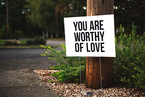 "Sign ""you are worthy of love"""